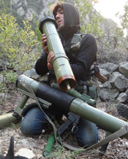 A Syrian opposition fighter checks a rocket launcher amid fighting last week in the country's disputed Latakia province. The Syrian government reported progress in efforts to retake territory near a seaport hosting the removal of its chemical weapons.