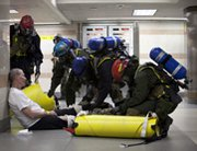 Response personnel help a mock victim during a 2012 biological preparedness drill in New York. The U.S. Defense Department has nearly completed a new military strategy for combating unconventional threats, Pentagon officials said on Tuesday.