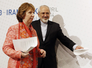 "European Union foreign policy chief Catherine Ashton and Iranian Foreign Minister Mohammad Javad Zarif arrive to give a press statement on Wednesday, the second day of a high-level meeting on Iran's disputed nuclear program. The officials said negotiators have held ""substantive and detailed discussions"" on all elements of a possible nuclear deal."