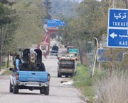 Syrian rebel fighters ride a pick-up truck through Latakia province on Friday. Russia's foreign ministry on Tuesday said Western governments had limited their efforts to secure Syrian chemical-arms shipments against opposition fighters.