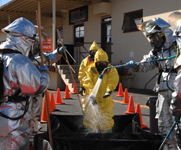 U.S. military biological laboratory personnel undergo decontamination during a 2007 exercise in California. Boston is set to convene a hearing this week on whether to ban the study of highly sensitive disease agents at a recently completed Boston University laboratory.