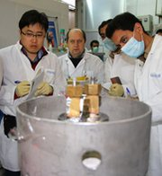 International Atomic Energy Agency inspectors and Iranian technicians disconnect some of Iran's uranium-enrichment centrifuges under a short-term multilateral agreement implemented in January. A top Iranian atomic official recently said his nation would need a larger enrichment capacity to meet its domestic electricity needs.