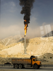 A gas flame is seen at Iran's South Pars gas field in January. An Iranian deputy oil minister on Monday downplayed prospects for energy-trade talks with Russia, amid international fears about the discussions' possible impact on nuclear sanctions against Tehran.