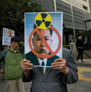 An activist holds an anti-North Korean placard showing leader Kim Jong Un during a rally in Seoul on Tuesday. Senior U.S. and Chinese diplomats discussed the North Korean situation earlier this week, amid concerns that a new nuclear test is in the works.