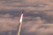 An unarmed Minuteman II intercontinental ballistic missile test-launches from Vandenberg Air Force Base, California. The United States plans to develop interoperable nuclear warheads for use on both land-based and submarine-launched ballistic missiles.