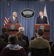 U.S. Defense Secretary Chuck Hagel and Polish Defense Minister Tomasz Siemoniak speak to the media at the Pentagon on Thursday. With tensions running high over Russia's incursion in Ukraine, the U.S. defense chief said planned European missile defenses could be adjusted depending on security needs.