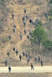 South Korean and U.S. soldiers march during a joint live-fire exercise at a military training field in Pocheon, northeast of Seoul, last Friday. North Korea reportedly has moved a mobile rocket launcher to its east coast, a possible sign of an imminent missile test.