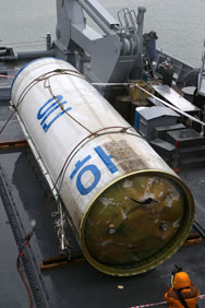 Debris from a long-range ballistic missile fired by North Korea in December 2012 is displayed at a naval base of South Korea's Second Fleet Command. The U.S. government has decreased how much unclassified information it publishes on weapons of mass destruction-related concerns, a congressional report says.