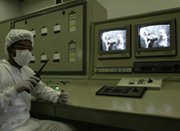 A technician watches surveillance monitors at Iran's Isfahan uranium-conversion facility in 2005. Iran on Monday said it is preparing a comprehensive list of its nuclear activities.