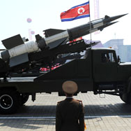 A North Korean missile is displayed during a military parade in Pyongyang in April 2012. The North is unlikely to have finished preparations for a new nuclear test before U.S. President Obama concludes his trip to the region this week, a new expert image analysis finds.