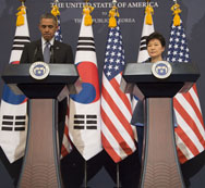 U.S. President Obama and South Korean President Park Geun-hye speak to the press in Seoul on Friday. The two leaders warned that harsh consequences would follow if North Korea carries out a fourth nuclear test, as appears increasingly likely.