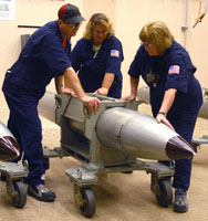 Production technicians prepare a B-61 for a surveillance test in 2006 at the Pantex Plant in Texas. In accordance with efforts to extend the service life of the nuclear gravity bomb, the U.S. Air Force is planning to test this summer how well a modified variant of the weapon separates from fighter jets.