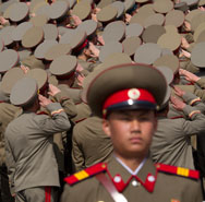 North Korean soldiers salute during a military parade in Pyongyang in April 2012. In its contingency planning for a possible war, the United States now treats North Korea as a nuclear-armed opponent, according to anonymous officials.