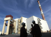 Personnel stand in 2010 outside the reactor building at the Russian-built Bushehr nuclear power plant in southern Iran. Iran and Russia are reportedly in talks on a possible multibillion-dollar energy deal that could undermine sanctions targeting Tehran's nuclear activities.
