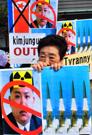 A South Korean activist holds placards that denounce North Korean leader Kim Jong Un at a March rally in Seoul. The North Korean foreign ministry on Tuesday said there was no time limitation for when the nation might carry out its fourth atomic test.