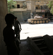 Syrian opposition fighters take cover near a rebel-operated tank in Aleppo earlier this month. According to a Western diplomat, the world's chemical-arms watchdog last week sent officials to Syria to discuss inconsistencies between an initial inventory of its chemical arms and materials removed from the country to date.