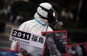 An anti-nuclear protester participates in a March rally in Tokyo on the eve of the two-year anniversary of the Fukushima Daiichi power plant meltdown. The White House has completed its review of an Environmental Protection Agency guide for responding to such incidents, potentially clearing the way for a relaxation of long-held cleanup standards (AP Photo/Junji Kurokawa).
