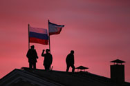 Cossack men install a Russian flag and a Crimean flag on the roof of the City Hall building on March 17 in Bakhchysarai, Ukraine. Obama administration officials on Tuesday downplayed the impact the Russian annexation of the region would have on nuclear security initiatives.