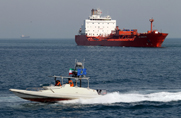 An Iranian Revolutionary Guard speedboat passes an oil tanker off of southern Iran in 2012. Insiders said Tehran and Moscow have achieved progress toward completing a potential oil-swap deal worth up to $20 billion.