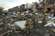 Fire department personnel walk among the remains of an apartment complex next to the fertilizer plant that exploded in April 2013 in West, Texas. House lawmakers are advancing legislation meant to extend the life of a Homeland Security Department program meant to help shield such facilities from terrorist attacks.
