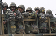 South Korean troops shown on Monday during maneuvers near the border with North Korea. Officials in Seoul have cited indications that Pyongyang might be preparing for its fourth nuclear test (AP Photo/Ahn Yong-joon).