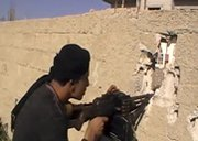 A Syrian rebel is shown in fighting last month near the border with Jordan. The Obama administration's top intelligence official on Thursday expressed doubt about the potential to secure Syria's chemical arsenal upon the potential fall of the Assad regime (AP Photo/Shaam News Network).