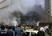 The aftermath of an April 8 car bombing in Damascus. British scientists are reported to have found evidence of a chemical arms attack near the capital city (AP Photo/Syrian Arab News Agency).