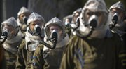 Israeli troops in gas masks train for response to chemical attacks in a 2009 exercise. Arab League nations and Israel are trading verbal barbs over the failure thus far to convene international talks on the idea of banning weapons of mass destruction from the Middle East (AP Photo/Sebastian Scheiner).