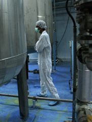 A technician works at Iran's Isfahan uranium conversion facility in 2007. A project at Isfahan to convert low-enriched uranium to a less weapon-usable form is behind schedule, the International Atomic Energy Agency said in a Thursday report.