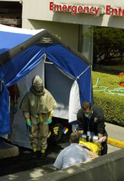 "A 2002 radiological ""dirty bomb"" drill in Seattle. Widespread fears of a major WMD terrorism attack on the United States have not come to pass in the years since the Sept. 11 attacks (AP Photo/Ted S. Warren)."