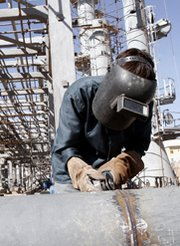 A welder works in 2004 at Iran's Arak heavy-water reactor facility. An Iranian official said Tehran would revamp the reactor to decrease its plutonium output.