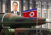 A possible mockup of a North Korean strategic ballistic missile is rolled out during an April 2012 parade in Pyongyang. The recent finding by the Pentagon's intelligence arm that the North has likely learned how to miniaturize nuclear warheads is not shared by other agencies, according to the U.S. national intelligence director (AP Photo/Ng Han Guan).