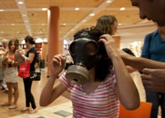 An Israeli girl tries on a gas mask at a Jerusalem-area shopping mall in July 2012. The United States and four other global powers on Friday reaffirmed their hopes to have Israel and all other Middle Eastern states attend a conference on establishing a WMD-free zone in the region (AP Photo/Sebastian Scheiner).