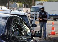 Police accompany judges during an investigation last October in Toulouse, where French self-proclaimed Islamic extremist gunman Mohamed Merah in 2012 stole a scooter and went on a shooting spree, killing seven. French officials want to stop extremists from traveling to Syria, where they might train for attacks in European nations.