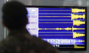 A television screen in Seoul shows seismic waves produced by North Korea's Feb. 12 nuclear test. An international nuclear arms control body on Tuesday said it had identified radioactive emissions that appear to be from the underground atomic blast (AP Photo/Lee Jin-man).