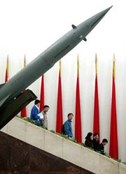 "A Chinese missile on display in 2003 at a military museum in Beijing. A new Chinese Defense Ministry white paper has raised some eyebrows by for the first time making no mention of the nation's long-held ""no-first-use"" policy for nuclear weapons (AP Photo/Greg Baker)."