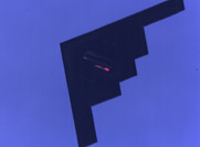 A U.S. B-2 bomber carries a mock B-61 nuclear gravity bomb during a 2011 trial flight conducted by the National Nuclear Security Administration and Air Force. A key Democrat suggested Wednesday that the Obama administration should simplify bomb refurbishment plans rather than cut funds from nonproliferation efforts (U.S. National Nuclear Security Administration photo).