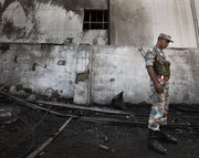A Syrian soldier checks out the site of an Aug. 15 bomb attack in Damascus. Talks with the Syrian government have reportedly persuaded Russia that the Assad regime would not use chemical warfare materials as it strives to defeat an armed rebellion (AP Photo/Muzaffar Salman).