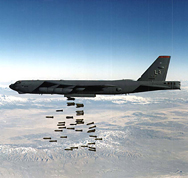 A U.S. B-52 bomber, shown dropping conventional explosives in an undated photo. If mandated budget cuts remain in place, the United States would face a choice of either spending funds on a next-generation bomber or maintaining the existing fleet of aging aircraft, Defense Secretary Chuck Hagel said on Wednesday (AP Photo/U.S. Defense Department).