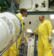 Personnel transfer a plutonium oxide container at the Savannah River Site in South Carolina. Mock terrorists reached a supply of simulated nuclear-bomb material during an exercise at the facility in January (U.S. National Nuclear Security Administration photo).