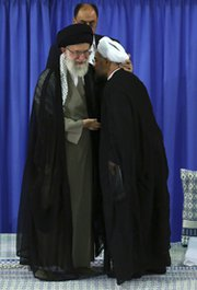 Iran's Hassan Rouhani, right, kisses the robe of Ayatollah Ali Khamenei on Saturday after receiving the supreme leader's formal endorsement to become the next Iranian president. Tehran and Washington marked Rouhani's inauguration by reaffirming hopes for a peaceful end to a long-running dispute over Iran's nuclear activities (AP Photo/Office of the Iranian Supreme Leader).
