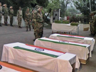 Indian military personnel salute fallen comrades at a Tuesday ceremony near the northern border with Pakistan. Five Indian soldiers reportedly died in a Tuesday attack at the disputed Kashmir boundary, possibly threatening plans for the nuclear-armed rivals to resume peace negotiations (AP Photo).