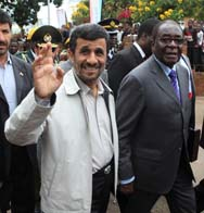 Zimbabwean President Robert Mugabe, right, shown in 2010 with then-Iranian President Mahmoud Ahmadinejad. Zimbabwe on Sunday denied a British news report that the nation had reached an agreement to sell uranium to Iran (AP Photo/Tsvangirayi Mukwazhi).