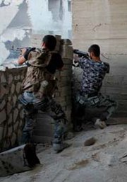 Syrian rebels open fire on government forces during a Monday battle in Aleppo. The United States has worked with Syria's neighbors in efforts to track movements of the country's chemical arms, according to the chairman of the U.S. Joint Chiefs of Staff (AP Photo/Aleppo Media Center).