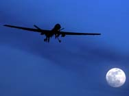 A U.S. Predator unmanned aerial vehicle flies over southern Afghanistan in 2010. Yemeni authorities reportedly recruited an 8-year-old boy to plant tracking devices on an alleged al-Qaida operative to be targeted in a U.S. drone strike (AP Photo/Kirsty Wigglesworth).