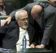 Iranian Foreign Minister Mohammad Javad Zarif, left, listens to Defense Minister Hossein Dehghan as lawmakers consider their nominations last Tuesday. Zarif agreed on Saturday to meet soon with a representative for six world powers in talks on his country's nuclear program (AP Photo/Ebrahim Noroozi).