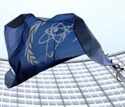 The flag of the International Atomic Energy Agency flies outside the organization's headquarters in Vienna, Austria. The U.N. nuclear watchdog has not yet been successful in convincing Israel and Arab countries to agree on a road map for a regional ban on atomic arms and other unconventional weapons, according to a new report by IAEA Director General Yukiya Amano's office (AP Photo/Hans Punz).