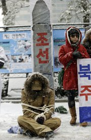 North Korean defectors protest against the regime's planned long-range rocket launch on Wednesday in Seoul, South Korea. A Wednesday news report said the North had completed installing the rocket's three stages on the launchpad (AP Photo/Lee Jin-man).
