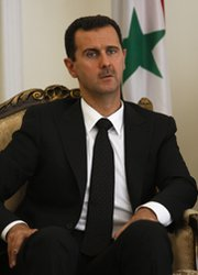 Syrian President Bashar Assad, shown during a 2009 trip to Iran. The United States and its allies are preparing contingency plans for a number of scenarios related to Syria's chemical arsenal, according to U.S. officials and experts (AP Photo/Vahid Salemi).