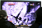 South Koreans on Sunday watch a television program on North Korea's planned rocket launch. Pyongyang on Monday announced that the launch window had been extended to Dec. 29 (AP Photo/Ahn Young-joon).